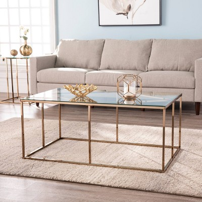 nicholas contemporary glass top cocktail table champagne aiden lane