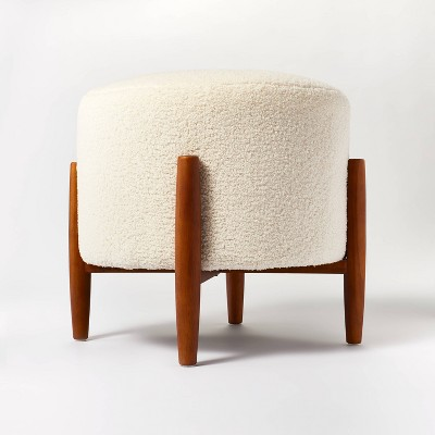 elroy sherpa round ottoman with wood legs cream threshold designed with studio mcgee
