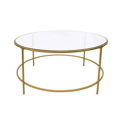 round metal framed coffee table with glass top gold and clear the urban port