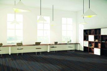 Interior of sunny creative office with wooden floor, windows and big desktop, 3D Render