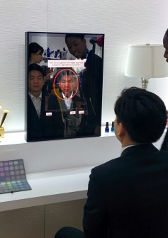 Mirror with built in skin recognition stuff - not sure why this guy is sitting in the chair.