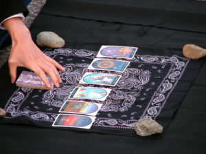 Accurate Tarot Reading Reviews Tarot Reader Laying a Spread on a Black Handkerchief with Stones at Each Corner
