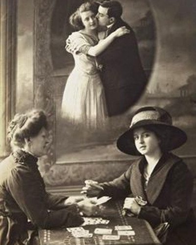 A woman ging another woman a tarot card reading, vintage photo