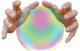 History of Psychics two hands hovering over a crystal ball against a white background