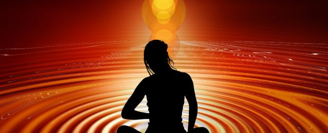 Psychic Abilities silhouette of a woman practicing awareness in a series of ripples around her