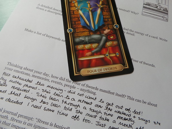 Gilded tarot four of swords with tarot journal page