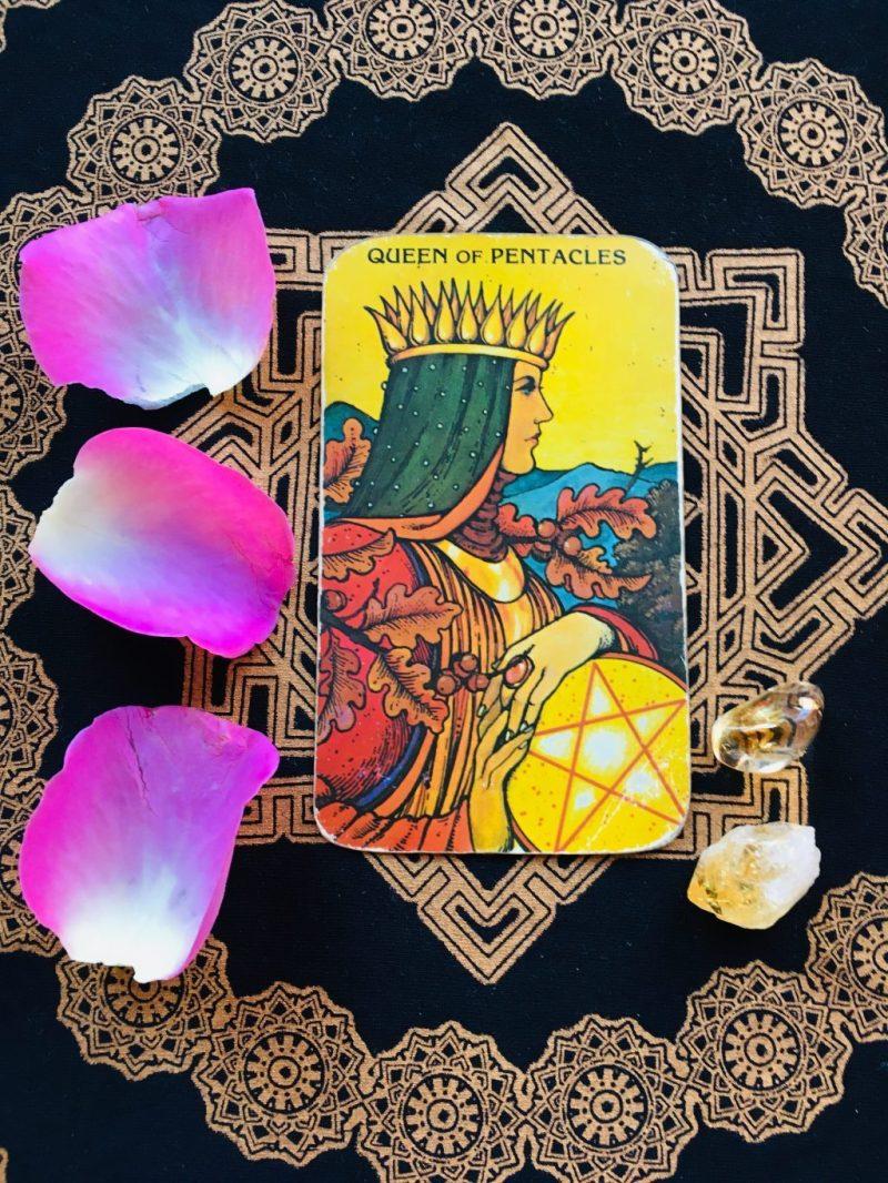 The Queen of Coins tarot card.