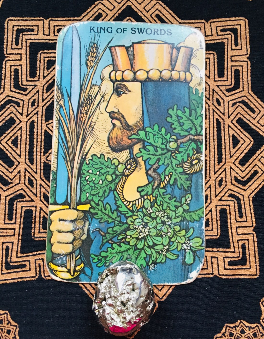 King of Swords and mental wisdom. He holds a sword and represents mental maturity.