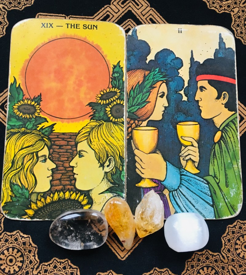 The Sun and Two of Cups. Joy and harmony. Two cards, depicting two couples looking to each other lovingly.
