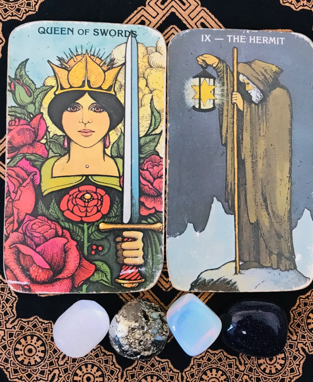 Be wise and be kind. Queen of Swords and Hermit Tarot cards.