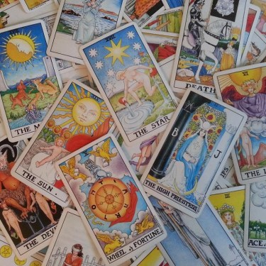 Image of scattered tarot cards in a pile
