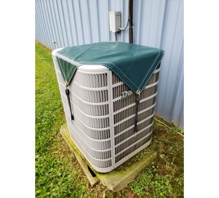 Green vinyl cover for outdoor a/c unit in winter.