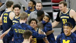 Michigan celebrates after defeating Ohio State in Columbus 92-87