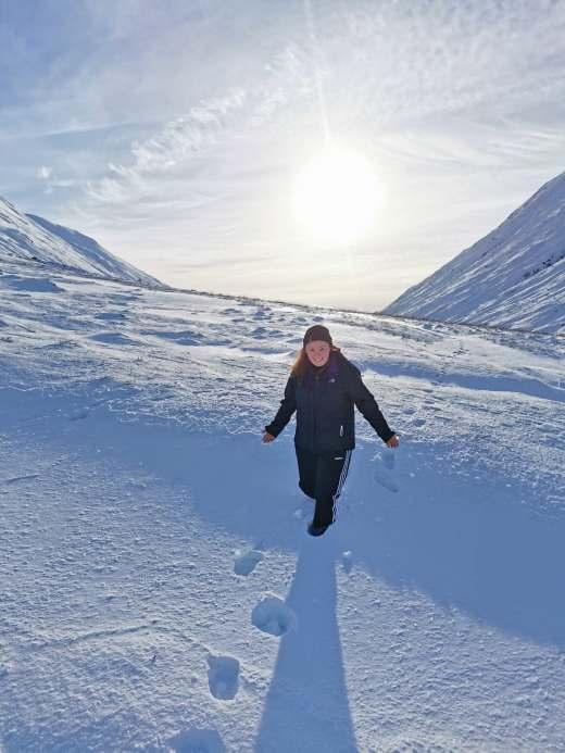 Girl on snowy hill scotland