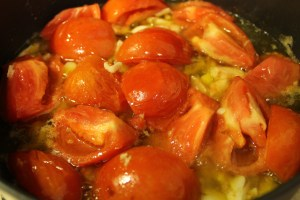 Cooking down the tomatoes and garlic.