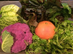 My haul: Purple Cauliflower, Red Chard, Savoy Cabbage, Grapefruit, Baby Arugula