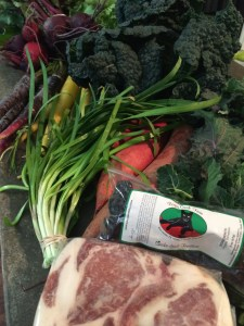 My haul: From Boggy Creek - Purple and Yellow Carrots; Sweet Potatoes; Dino Kale; Maria's Brassica Salad; Larry's Smoked Dried Tomatoes; Pork Loin Chops from Peaceful Pork.  From Springdale Farm - Red Beets; Garlic Chives (I was really excited about those. They're so much better than regular chives.)
