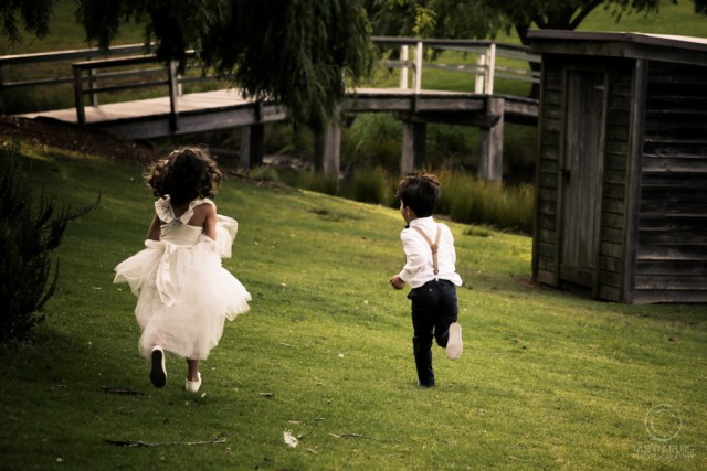 pageboy and flower girl running