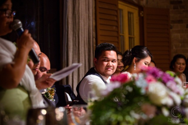 groom-watching-father-during-speeches