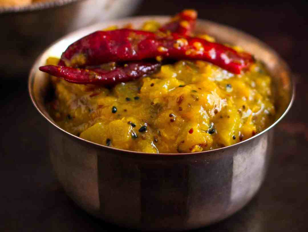 Aam Ki Launji / Raw Mango Chutney summer's favourite condiment! This palate tickling,sweet sour spicy vegan chutney is a breeze to make..