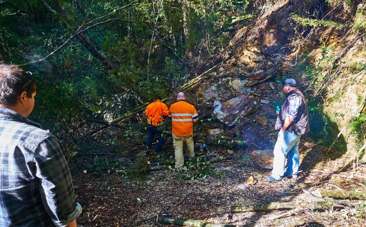 Clearing a very recent landslide