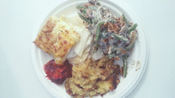 Scalloped Potatoes, Green Bean Casserole, Cranberry Relish, and Pecan Sweet Potatoes at Cali Kitchen. Taken by Edward Avila.