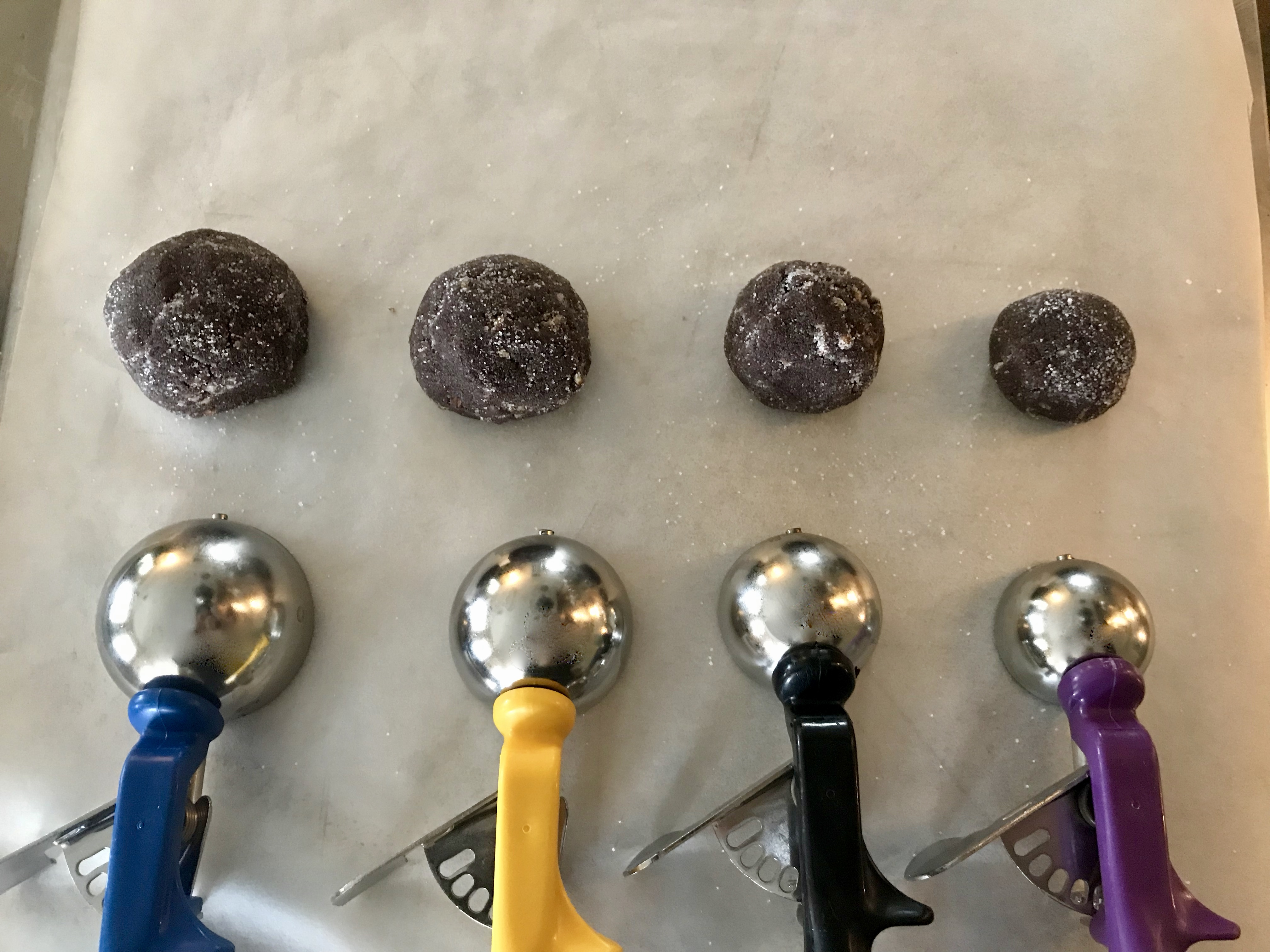 Different dishers with varying sizes of cookie dough
