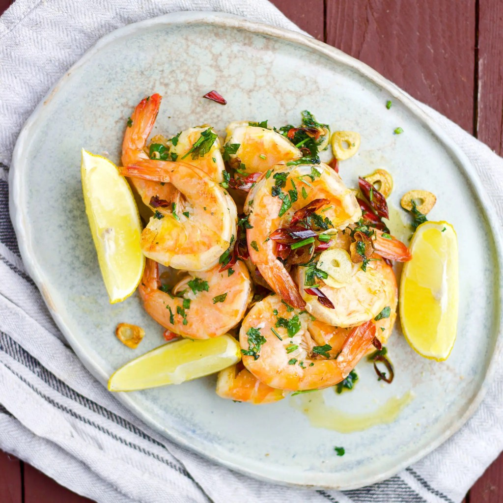 5 minutes tiger prawns with garlic, chilli and parsley.