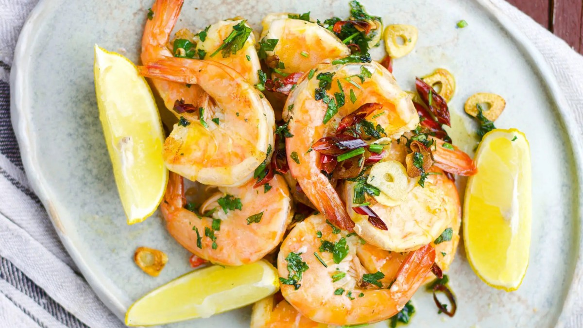 5 minutes tiger prawns with garlic, chili, and parsley.
