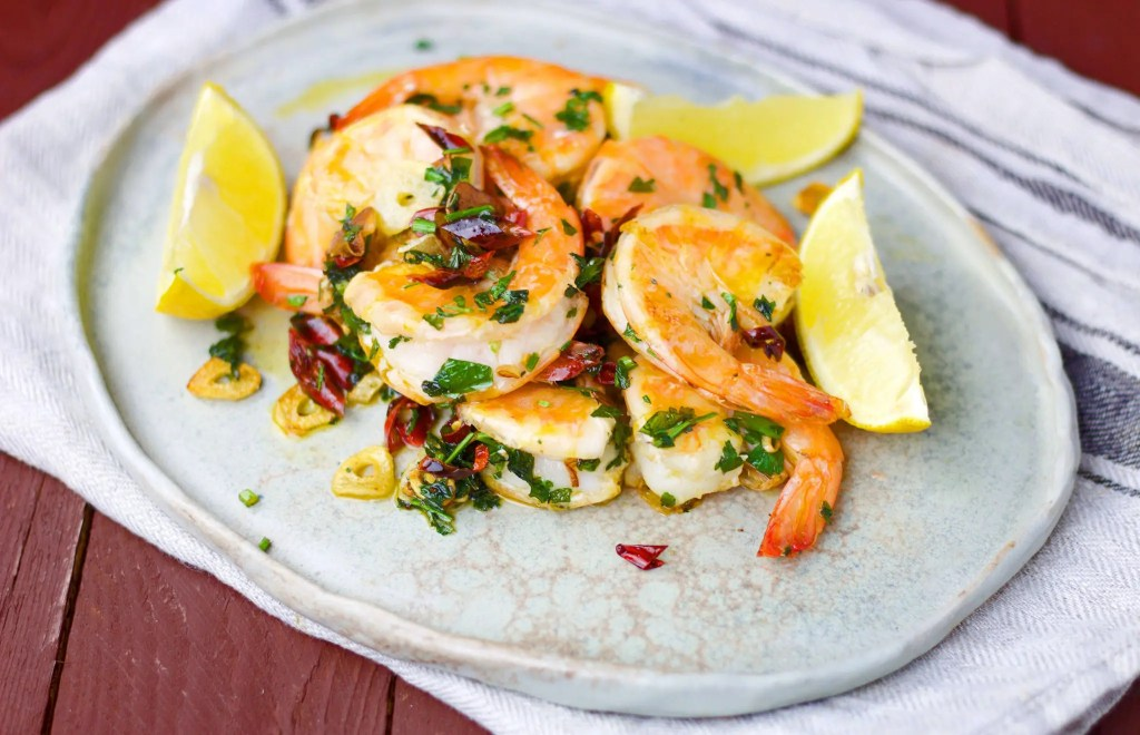 5 minutes tiger prawns with garlic, chilli, and parsley.