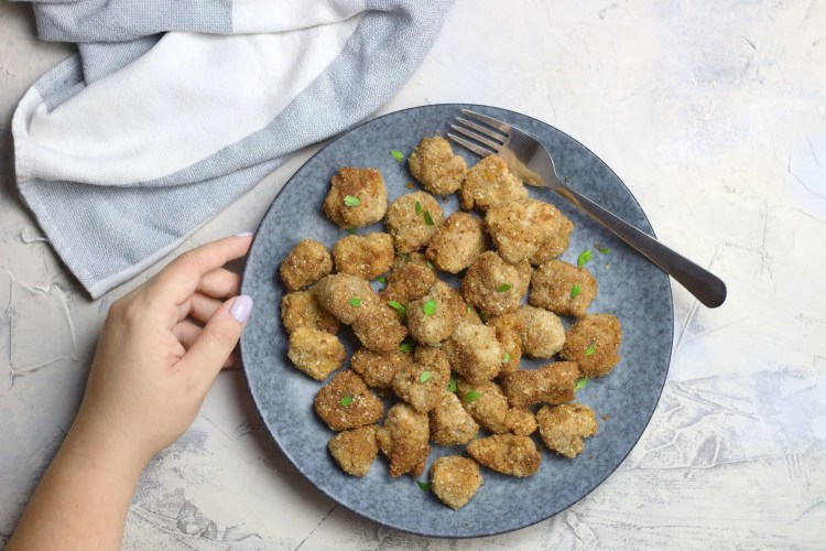 Quinoa flake and walnut thyme chicken popcorn