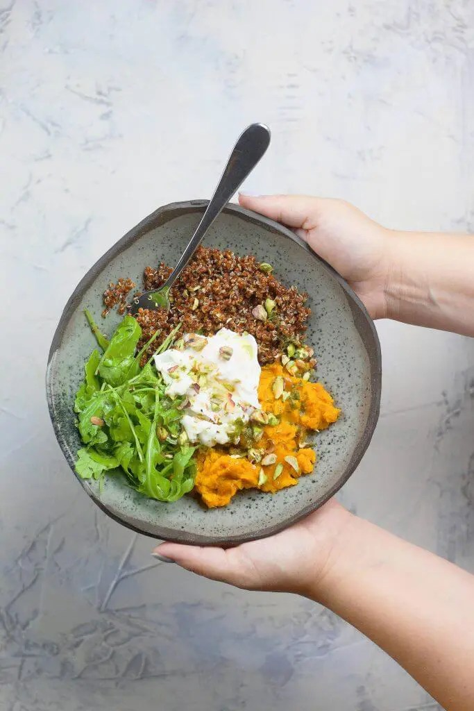 Healthy bowl with red quinoa (sweet potato, poached eggs, and lemon dressing)