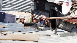 A wave from the neighbours, deep in the squatter camp, inviting us to join them for a beer.
