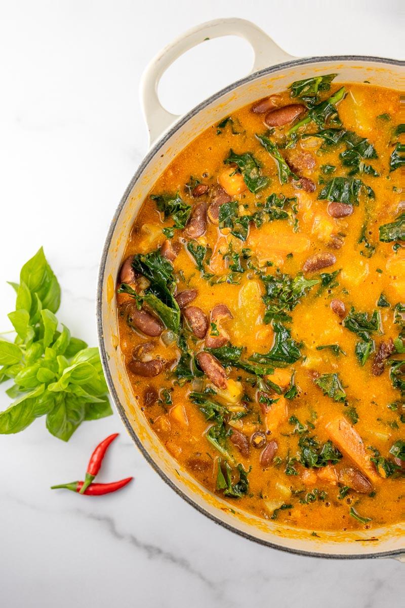 Vegan Panang Curry Soup with Kale, Beans + Sweet Potato