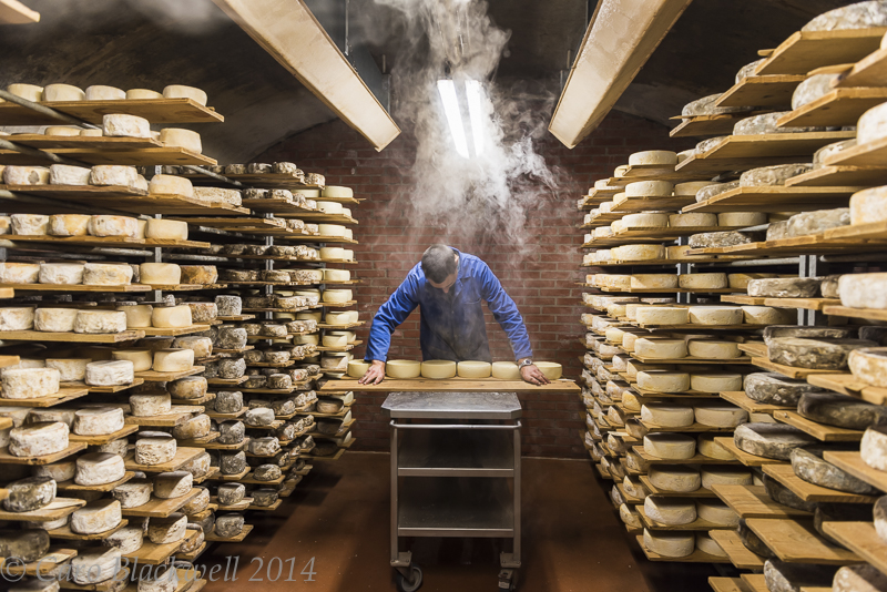 Turning and checking the Tomme de Savoie