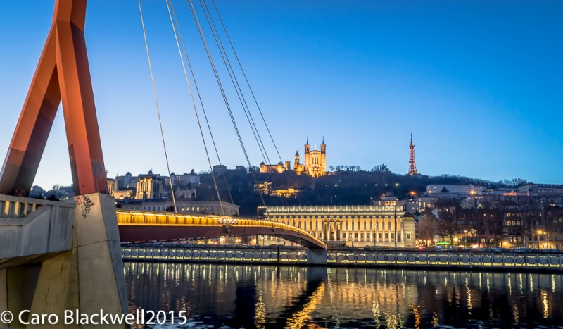 Looking over to the Basilique de Fourvière with the law courts in front on the bank of the river Saône
