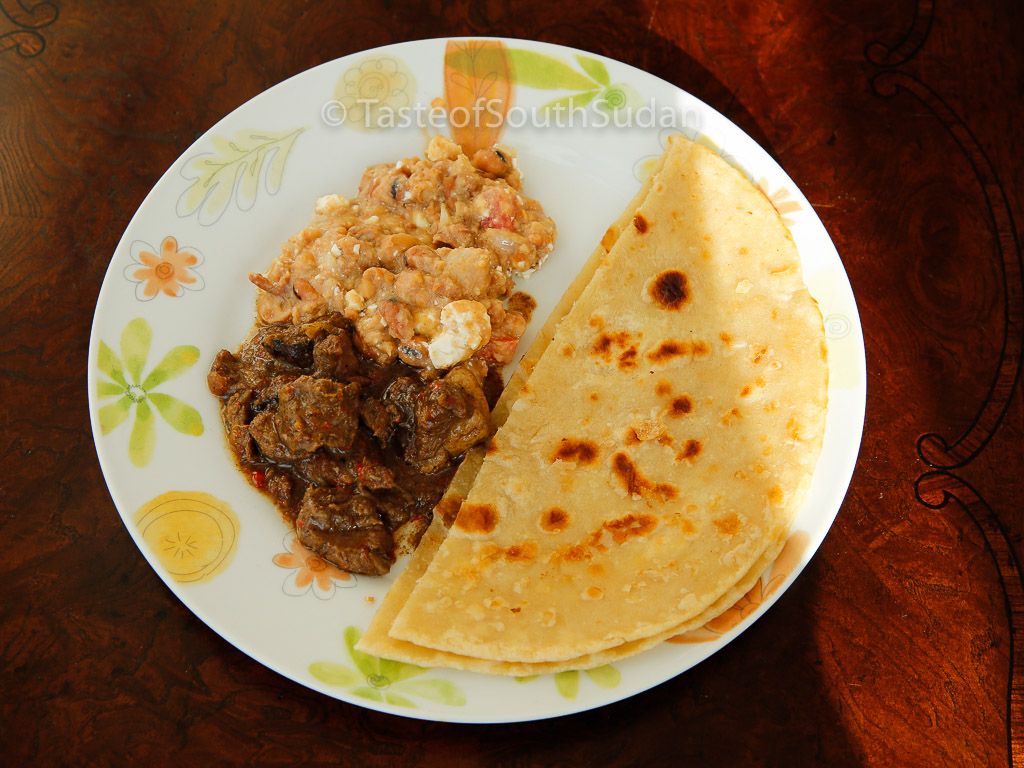 Chapati served with Ful medames and beef stew. Taste of South Sudan, East African Chapati, Kenyan chapati, indian flat bread