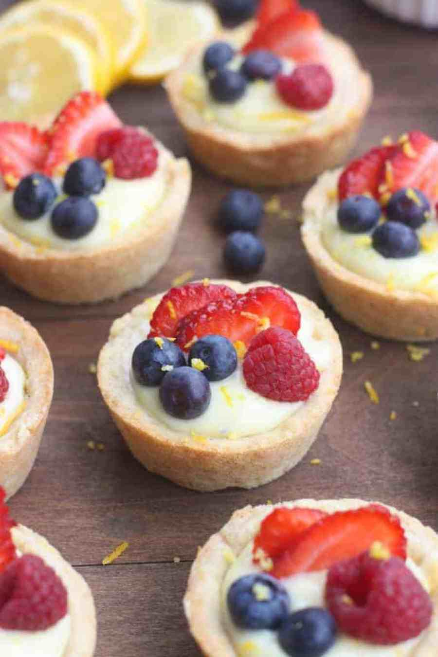 Creamy Lemon Sugar Cookie Cups - my favorite sugar cookie recipe baked in a muffin tin and filled with creamy lemon pie filling. Topped with fresh fruit. A beautiful and easy dessert that will impress your guests!
