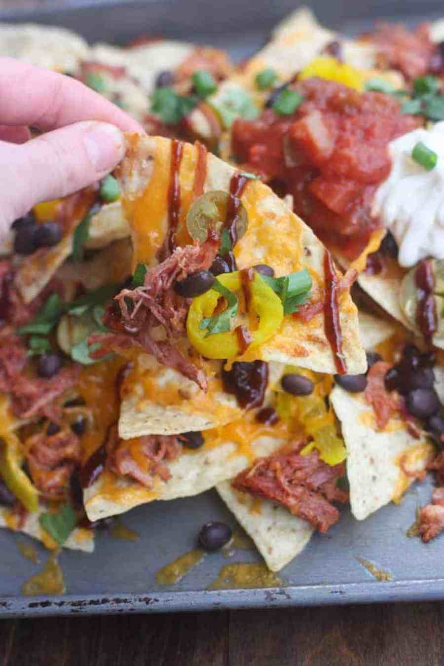 BBQ Pulled Pork Nachos for a fun and easy party appetizer! These are always a huge hit! | Tastes Better From Scratch