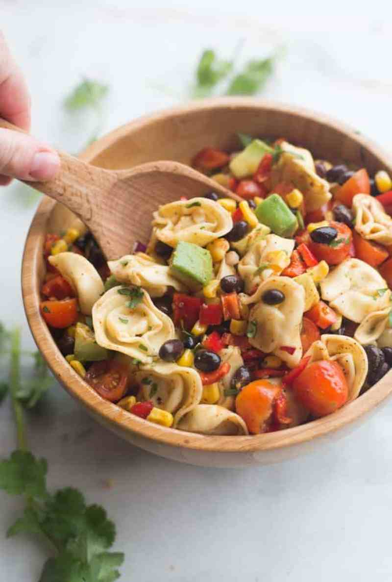 A fresh and easy southwest tortellini pasta salad that can be made in less than 30 minutes! It's loaded with veggies and protein and coated in a deliciously simple and healthy southwest dressing. | Tastes Better From Scratch