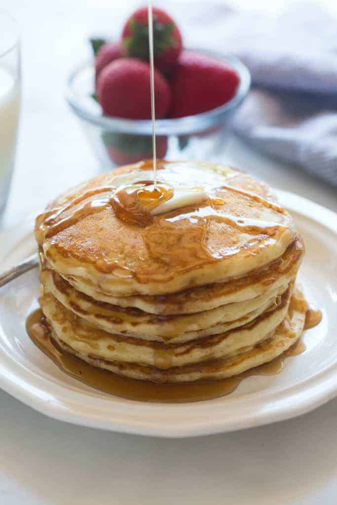 No one can resist a stack of delicious homemade buttermilk pancakes, and this recipe is fantastic! The most light, fluffy, buttery pancakes.| tastesbetterfromscratch.com