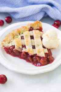 Ditch the canned cherry pie filling for this super easy and yummy homemade cherry pie! You can use fresh cherries or canned cherries so that you can enjoy this pie all year round!   tastesbetterfromscratch.com
