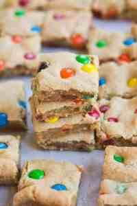 M&M Cookie bars and soft, thick and chewy and perfect for an easy dessert to bring to parties and potlucks! | tastesbetterfromscratch.com