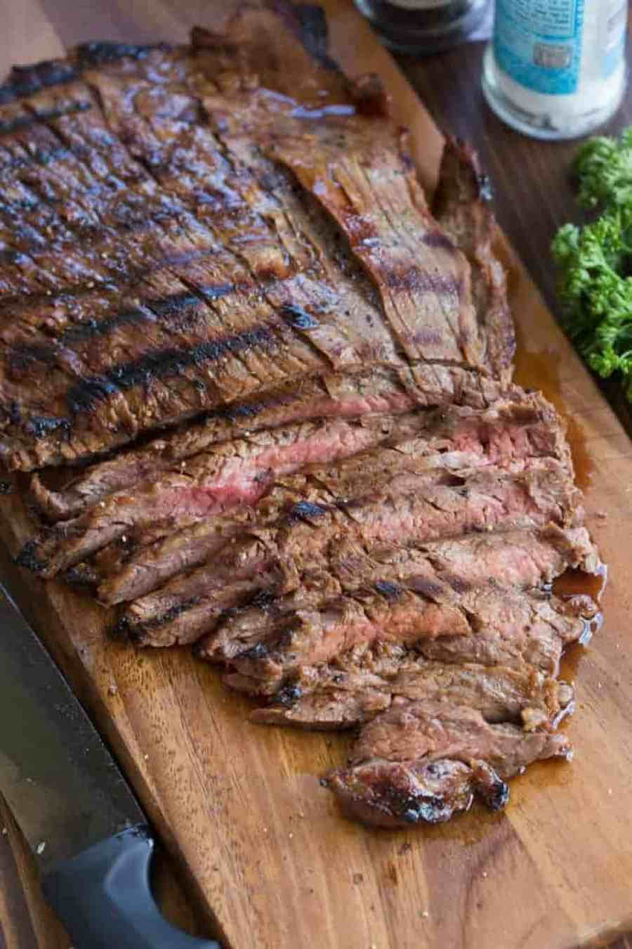 The BEST, easiest marinated flank steak recipe. The recipe has been in my family for decades and is seriously the BEST! | tastesbetterfromscratch.com