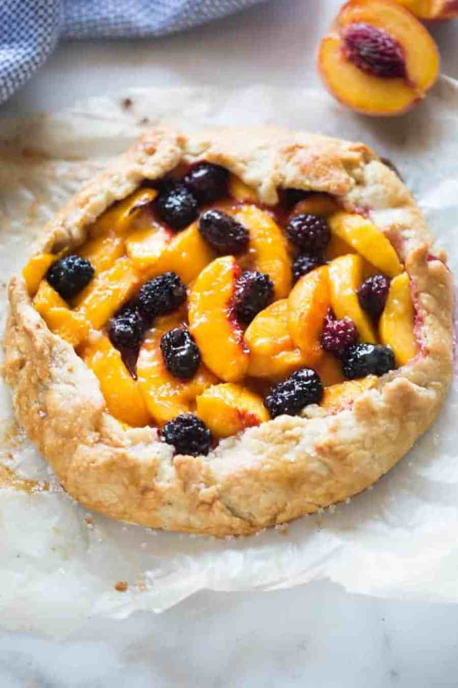 "This Peach Blackberry Tart is pretty enough to seem ""fancy"" and impressive, but it couldn't be easier to make! A great easy dessert idea for your fresh summer peaches and blackberries. 