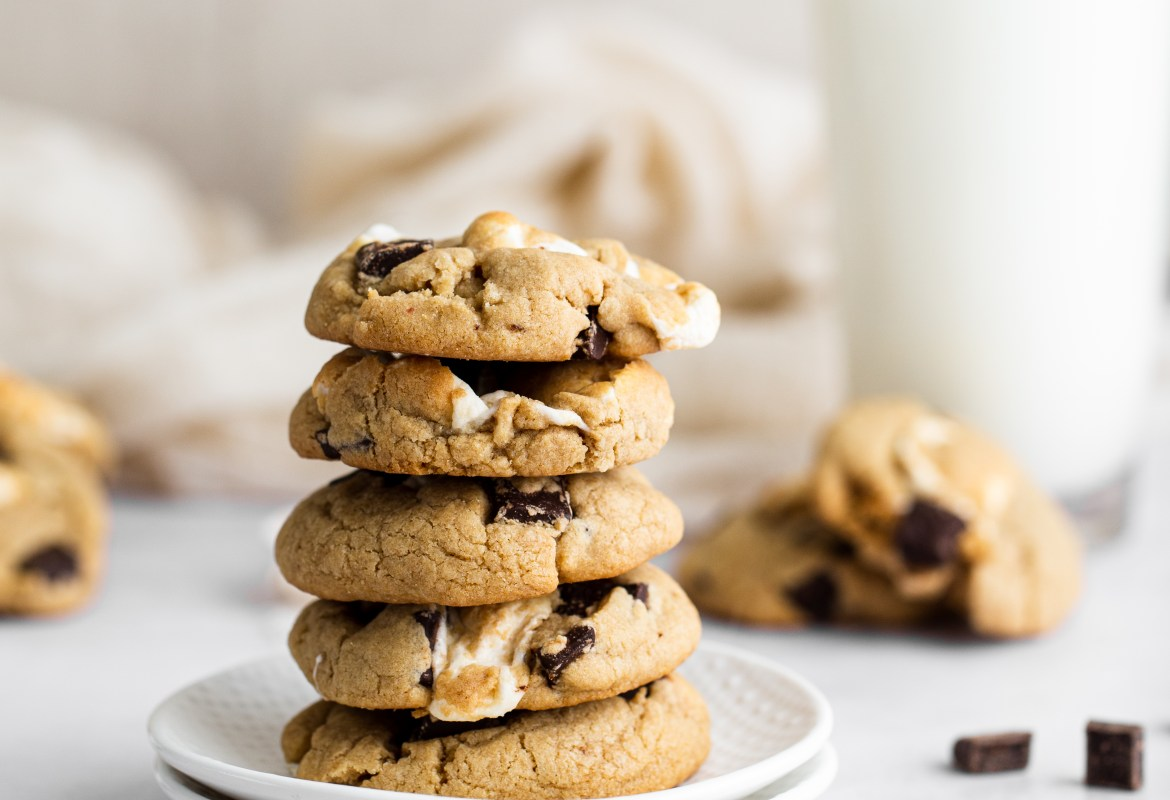 chocolate chunk s'more cookies stacked on a plate