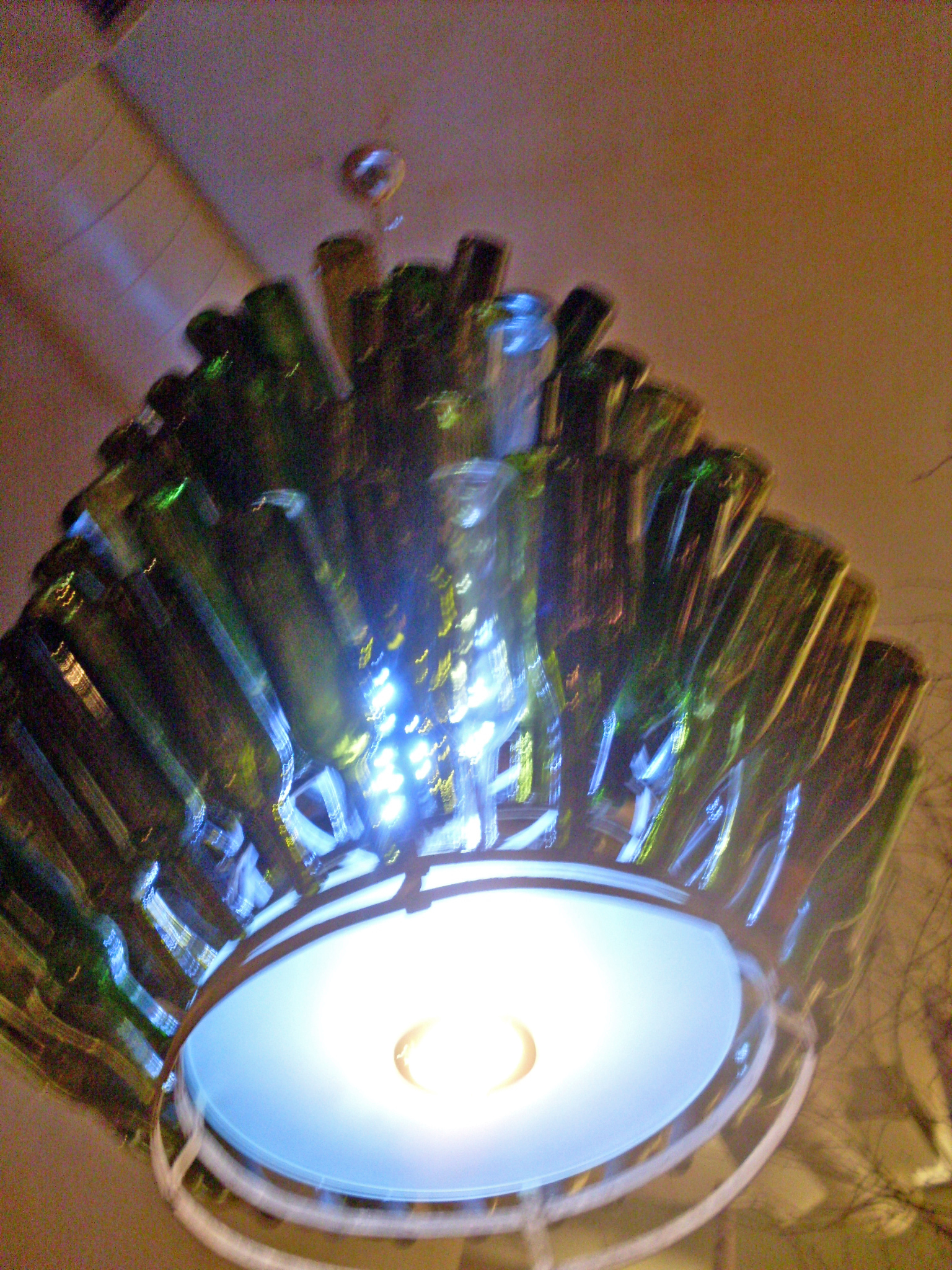 The chandelier over our table, made from antique wine bottles.