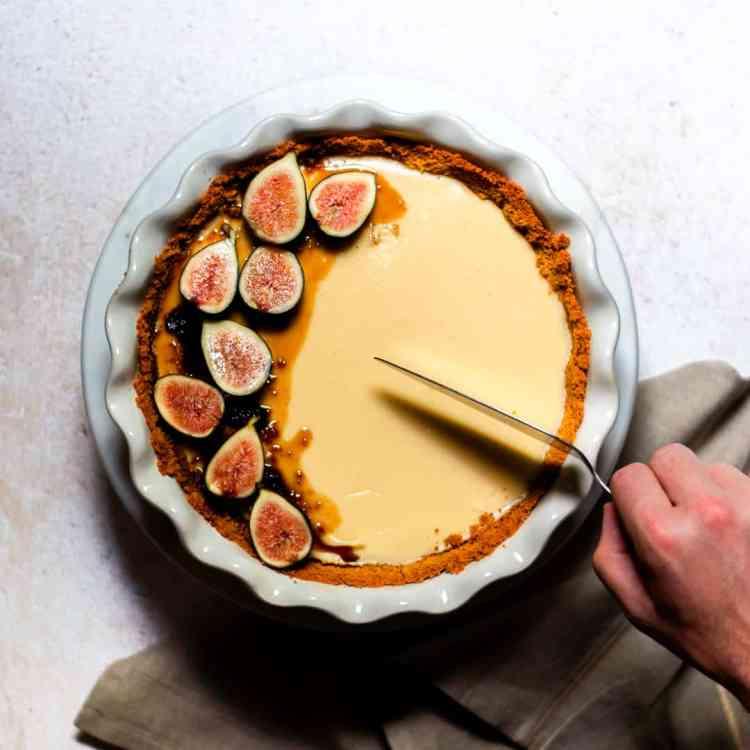Hand cutting fig cheesecake