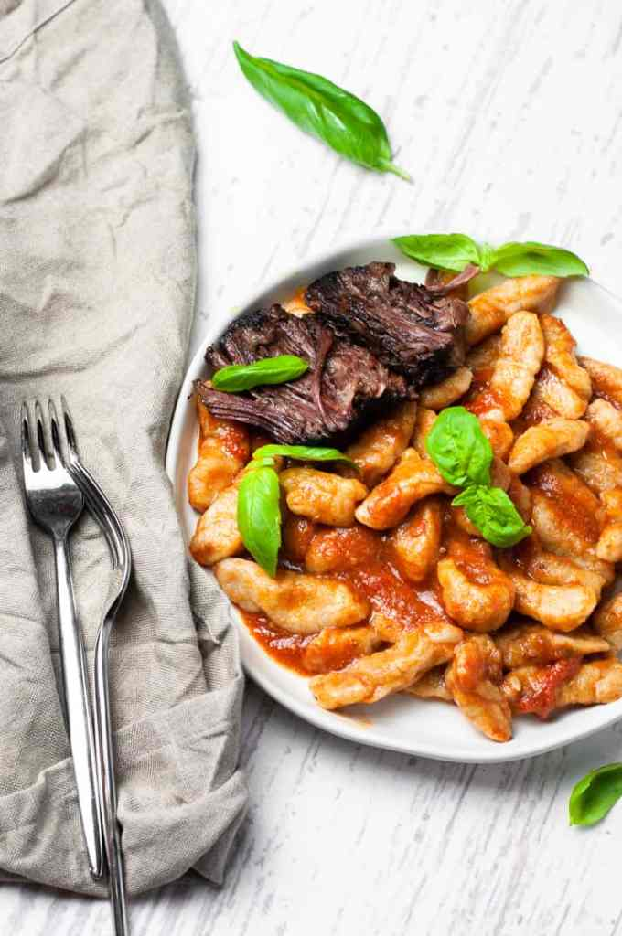 homemade gnocchi with short ribs and red sauce