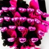 22 pink foil wrapped milk chocolate hearts surrounded by pink & black cello in a small black box.